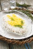 Traditional homemade salad Mimosa with fish, vegetables and eggs. Soviet life. Rustic style, selective focus. Royalty Free Stock Photography