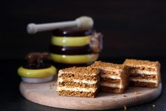 Traditional honey cake. Slices of honey cake with butter cream Royalty Free Stock Photography