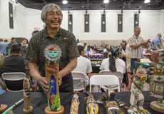 Traditional Hopi Kachina Doll Artist Showing Work. PHOENIX - April 12: Unidentified artist displays his hand-crafted Royalty Free Stock Photography