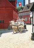 Traditional horse chariot and wooden houses at den gamble by in Aarhus royalty free stock images