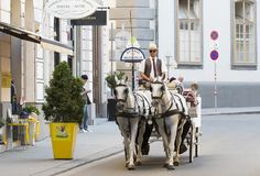 Traditional horse-drawn carriages with cabs for tourists to walk along the ancient streets of Vienna. Royalty Free Stock Photography