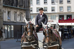 Traditional horse-drawn carriages with cabs for tourists to walk along the ancient streets of Vienna. Royalty Free Stock Image