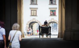Traditional horse-driven carriage with tourists Royalty Free Stock Photography