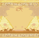 Traditional Horus Eye and camel caravan Royalty Free Stock Photos
