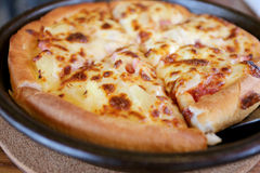 Traditional of hot cheese pizza on pan. Stock Photos