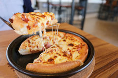 Traditional of hot cheese pizza on pan. Royalty Free Stock Photos