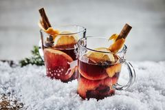Traditional hot spicy mulled Gluhwein for Xmas. Traditional hot spicy mulled Gluhwein or red wine for Christmas with orange, cinnamon and star anise served in Royalty Free Stock Image