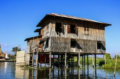 Traditional hous on stilts in Inle lake, MyanmarBurma. Traditional hous on stilts in Inle lake on a sunny day, MyanmarBurma Stock Photo