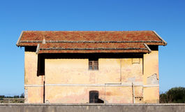Traditional house, background, high constrast. A front view of a traditional house, with large roofs covered with tiles, high contrast picture, landscape cut stock images