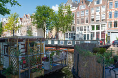 Traditional house boat on the canals of Amsterdam. Stock Photography