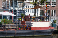 Traditional house boat on the canals of Amsterdam. Royalty Free Stock Photos