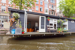 Traditional house boat on the canals of Amsterdam. Stock Image