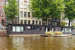 Traditional house boat on the canals of Amsterdam. Royalty Free Stock Images
