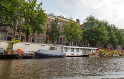 Traditional house boat on the canals of Amsterdam. Royalty Free Stock Photography