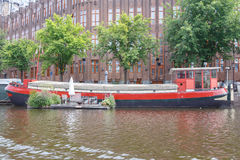 Traditional house boat on the canals of Amsterdam. Stock Photos