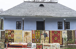 Traditional house with carpets exposed in front. Royalty Free Stock Images