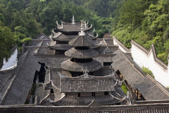 Traditional  house in China. Traditional  house with tile roof in a forest with lots of trees in China,front view Royalty Free Stock Photos
