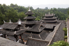 Traditional  house in China. Traditional  house with tile roof in a forest with lots of trees in China,side view Royalty Free Stock Images