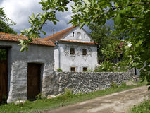Traditional house in Comanesti, Romania. Traditional peasant house in Comanesti, Transylvania, Romania, made in the 1800-s, from stone Royalty Free Stock Photography