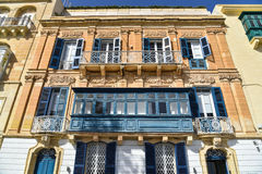 Traditional house facade Malta. Valletta Malta downtown house with blue balconies, shutters and doors, facade view Stock Images