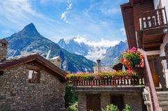 Traditional house with flowers in Courmayeur Stock Images