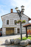 Traditional House and Lantern in Bansko. A view of a traditional Bulgarian building and a lantern in the center of Bansko. Bansko is a town in southwestern Royalty Free Stock Image