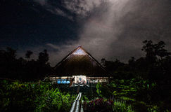 Traditional house Mentawai tribe in the jungle at night. Stock Image