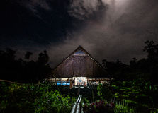 Traditional house Mentawai tribe in the jungle at night. Stock Images