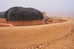 Traditional house in morning fog, Thar desert, India Royalty Free Stock Image