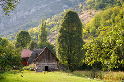 Traditional house in mountains. Traditional romanian house in carpathians mountains with green pasture and meadow Royalty Free Stock Photo