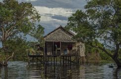 Traditional house near a floating village Cambodia Stock Photo