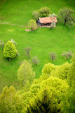 Traditional house on a spring hill Stock Images