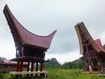 Traditional house from Toraja, West Sulawesi, well known as Tongkonan with the cloudy sky background