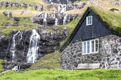 Traditional house with turf roof in Saksun, Faroe Islands Royalty Free Stock Images