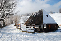 Traditional house  in winter in a mountain village Royalty Free Stock Images
