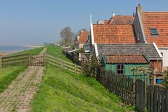Traditional houses along a in Makkum, historic Dutch village royalty free stock photo