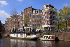 Traditional houses and boats in Jordaan neighborhood and canals stock image