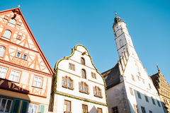 Traditional houses and a church in the main square in Rothenburg ob der Tauber in Germany. European architecture.  Royalty Free Stock Photo