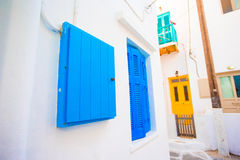 Traditional houses with colorful doors in the narrow streets of Mykonos, Greece. Stock Photo