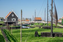 Traditional houses Dutch fishing village with nets drying in wind Stock Photography