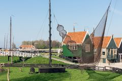 Traditional houses Dutch fishing village with nets drying in wind Royalty Free Stock Photography