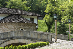 Traditional houses froom east Europ. Traditioonal hoouse from wood and stone stock photos