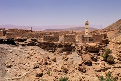 Traditional houses made of brick minaret in the background, Morocco Royalty Free Stock Photos