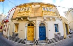 Traditional houses in Malta. Fisheye lens used. Artistic interpr. Etation Royalty Free Stock Photos
