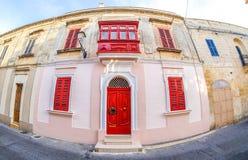 Traditional houses in Malta. Fisheye lens used. Artistic interpretation Royalty Free Stock Photo