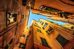 Traditional houses in a narrow street in Genoa, Italy Royalty Free Stock Image
