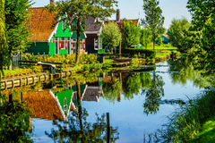 Traditional Houses reflecting in the Canal in the Historic Village of Zaanse Schans Stock Photos
