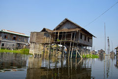 Traditional houses on stilts Stock Images