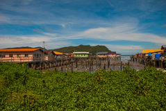 Traditional houses on stilts over the water. Sandakan, Borneo, Sabah, Malaysia. Traditional houses on stilts over the water. Sandakan city, Borneo, Sabah stock image