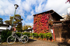 Traditional houses in a street of the old city area in autumn, Takayama, Gifu prefecture, Japan Royalty Free Stock Images